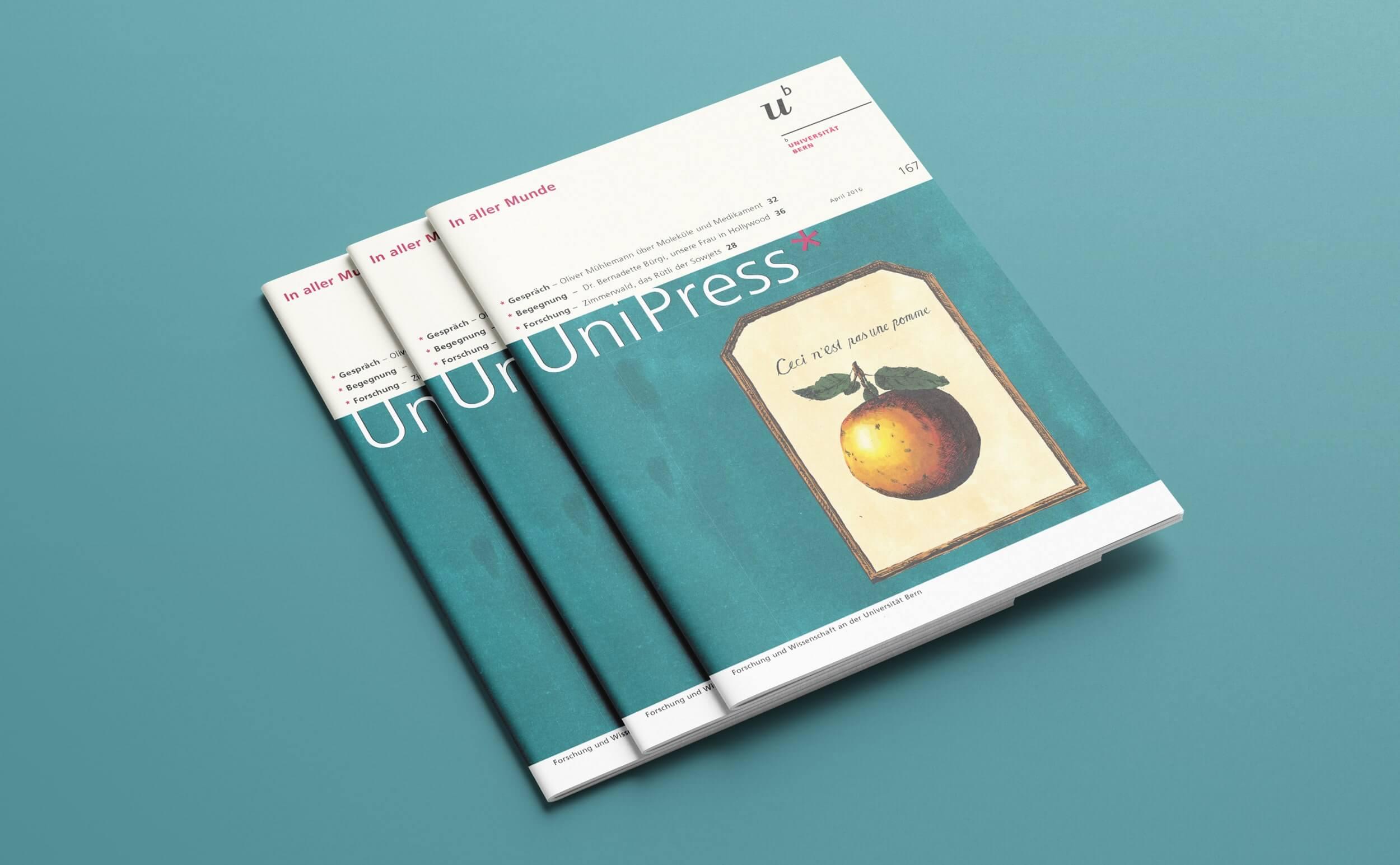 unipress magazine mit apfel illustrationen darauf